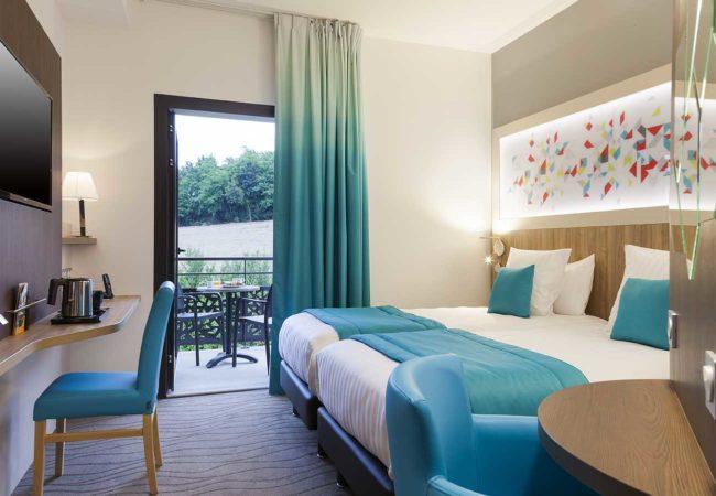 Chambre_1_Hotel_comfort_figeac_le_drauzou_chambre_trois_etoiles_piscine_jacuzzi_restaurant_bar_terrasse_seminaires_parking_jardin_jeux_slider