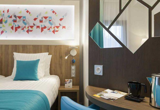 Chambre_6_Hotel_comfort_figeac_le_drauzou_chambre_trois_etoiles_piscine_jacuzzi_restaurant_bar_terrasse_seminaires_parking_jardin_jeux_slider